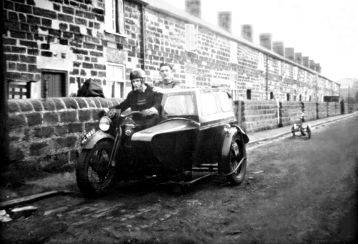 Motor cycle and sidecar at Stone Row, Jacksdale. Stone Row was demolished in the 1970s and ran down the lane behind Jacksdale Social Club and the present day dental surgery
