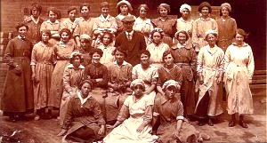 'Polly' Atkin, wife of Charles Alfred Atkin, working at the Clay Pipe Works, far left, hand in apron pocket